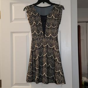 Black and cream lace dress with sheer detail